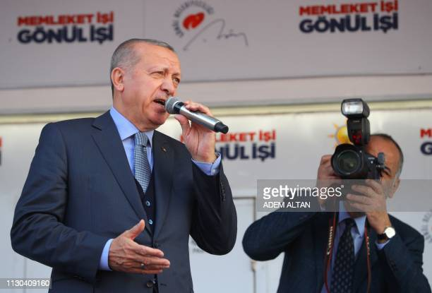 Turkish President and leader of Turkey's ruling Justice and Development Party Recep Tayyip Erdogan delivers a speech during his party's campaign...