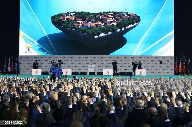 Turkish President and ruling Justice and Development Party chairman Recep Tayyip Erdogan addresses an AK Party presentation of mayoral candidates for...