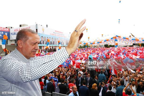 Turkish President and the leader of the Justice and Development Party Recep Tayyip Erdogan greets people during AK Party's rally in southern Antalya...