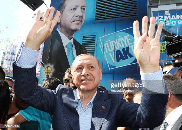 Turkish President and the leader of the Justice and Development Party Recep Tayyip Erdogan greets the crowd as he attends Turkey's ruling AK Partys...