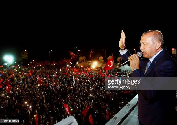 Turkish President and the leader of the Justice and Development Party Recep Tayyip Erdogan addresses to public on a bus outside Turkish Presidency's...