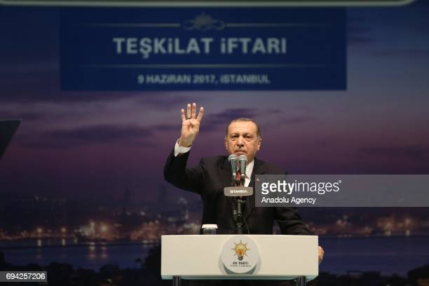 Turkish President and the leader of the Turkey's ruling Justice and Development Party Recep Tayyip Erdogan flashes Rabia sign as giving a speech...
