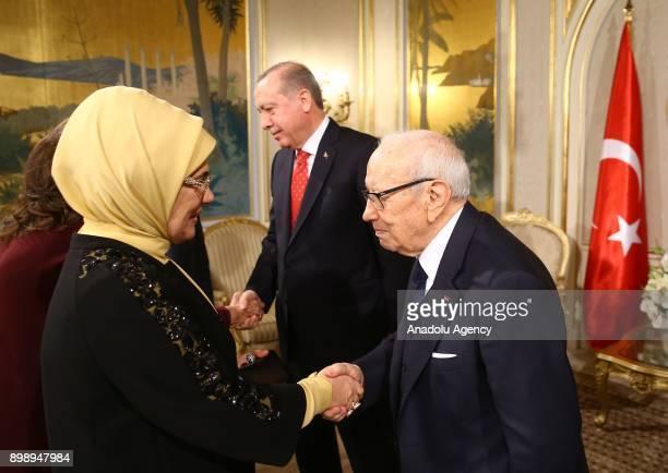 Turkish President Erdogan's wife Emine Erdogan shakes hands with Tunisian President Beji Caid Essebsi as he hosts a luncheon in honour of President...