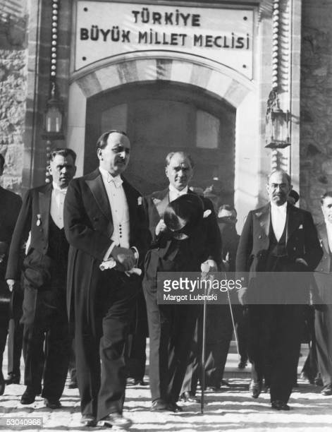 Turkish president Kemal Ataturk leaves the Grand National Assembly in Ankara with Persian Foreign Minister Firughi Khan after signing a treaty of...