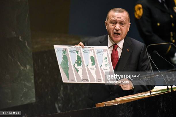 Turkish President Recep Tayyip Erdoan holds a map of Israel during his speech at the United Nations General Assembly on September 24, 2019 in New...