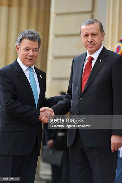 Turkish president Recep Tayyip Erdoga shakes hands with Juan Manuel Santos president of Colombia upon he arrives at Narino Presidential Palace for a...