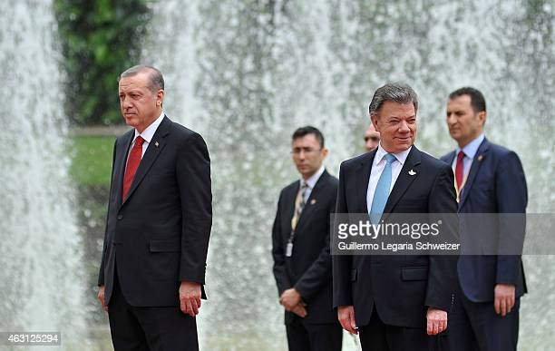 Turkish president Recep Tayyip Erdoga stands next to Juan Manuel Santos president of Colombia during a welcoming ceremony upon he arrives at Narino...