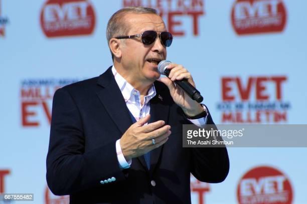 Turkish President Recep Tayyip Erdogan addresses during 'Izmir Gathering' ahead of the constitutional referendum on April 9 2017 in Izmir Turkey
