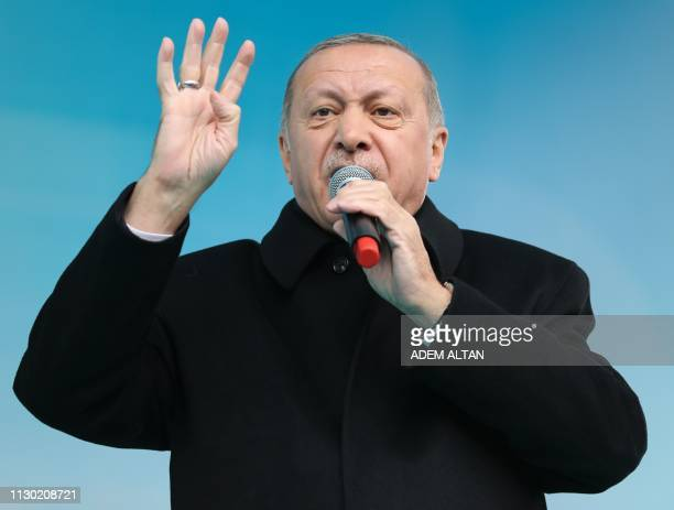 Turkish President Recep Tayyip Erdogan addresses the crowd during a campaign rally of the Turkey's ruling Justice and Development party in Ankara's...