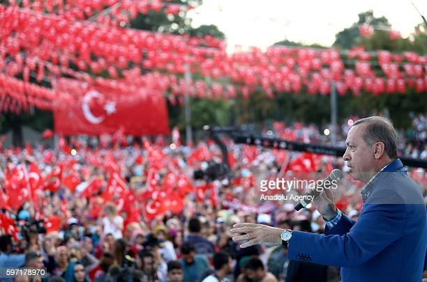 Turkish President Recep Tayyip Erdogan addresses the crowd during a meeting 'Unity Solidarity and Brotherhood' at 15 July Democracy square in...