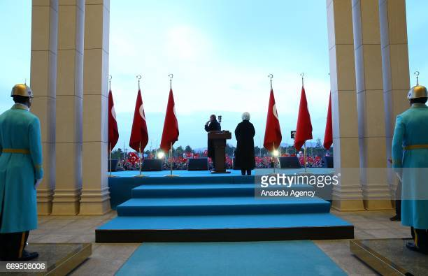 Turkish President Recep Tayyip Erdogan addresses the crowd who are celebrating the results of the referendum at the Presidential Complex in Ankara...