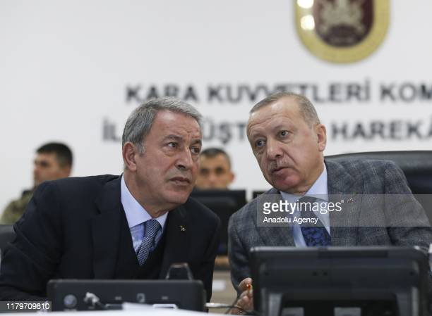 Turkish President Recep Tayyip Erdogan along with Turkish National Defense Minister Hulusi Akar is being informed on border units in Sanliurfa,...