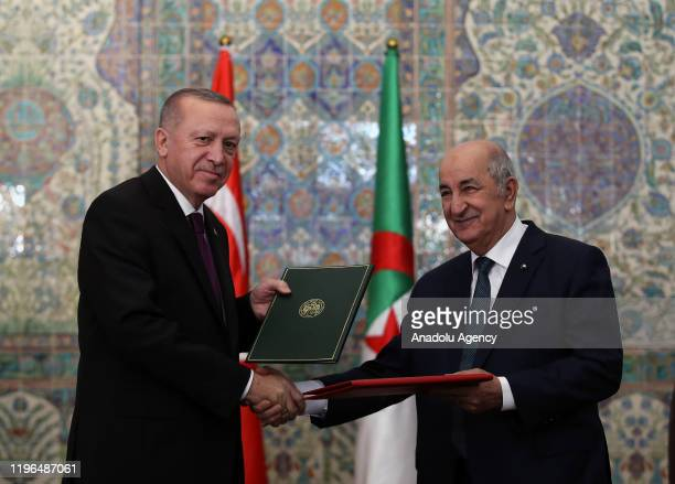 Turkish President Recep Tayyip Erdogan and Algerian President Abdelmadjid Tebboune pose for a photo after signing bilateral agreements between Turkey...