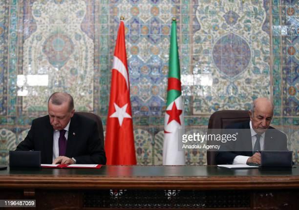 Turkish President Recep Tayyip Erdogan and Algerian President Abdelmadjid Tebboune sign bilateral agreements between Turkey and Algeria in a joint...