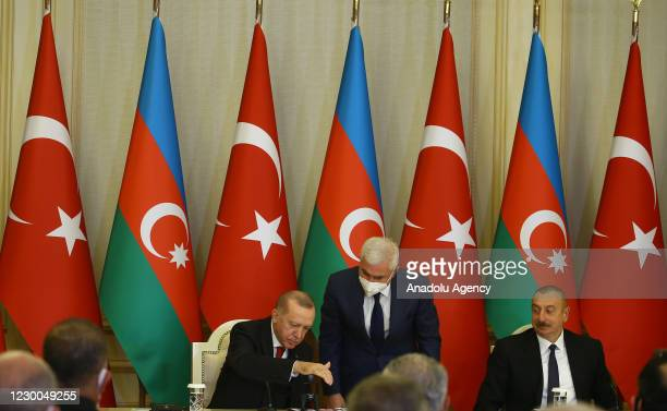 Turkish President Recep Tayyip Erdogan and Azerbaijani President Ilham Aliyev seal the postage stamp and a first day of issue cover in the memory of...