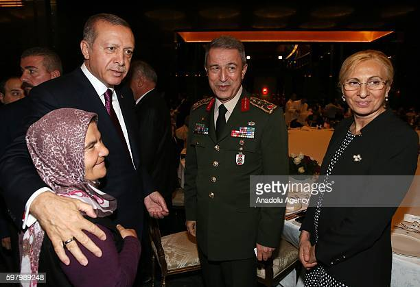 Turkish President Recep Tayyip Erdogan and Chief of the General Staff of the Turkish Armed Forces Hulusi Akar talk with citizens during a dinner...