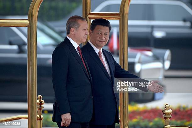 Turkish President Recep Tayyip Erdogan and Chinese President Xi Jinping prepare to inspect Chinese honor guards during a welcome ceremony outside the...