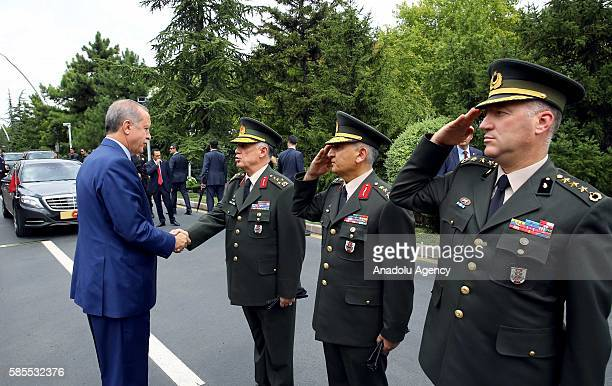 Turkish President Recep Tayyip Erdogan and Deputy Chief of the Turkish General Staff Umit Dundar shake hands during a welcoming ceremony at Turkish...