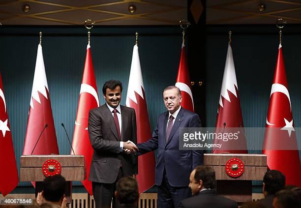 Turkish President Recep Tayyip Erdogan and Emir of Qatar Sheikh Tamim bin Hamad bin Khalifa Al Thani shake hands following their meeting at...