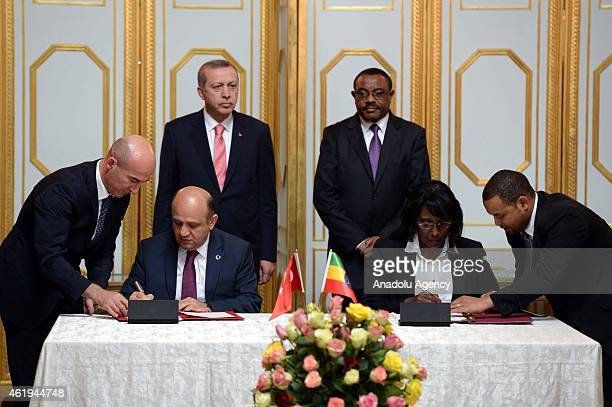 Turkish President Recep Tayyip Erdogan and Ethiopian Prime Minister Hailemariam Desalegn stand as Minister of Science, Industry and Technology Fikri...