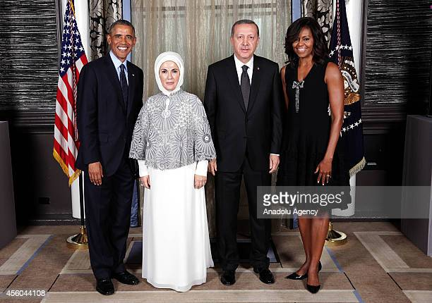 Turkish President Recep Tayyip Erdogan and First Lady Emine Erdogan US President Barack Obama and First Lady Michelle Obama pose ahead of a reception...