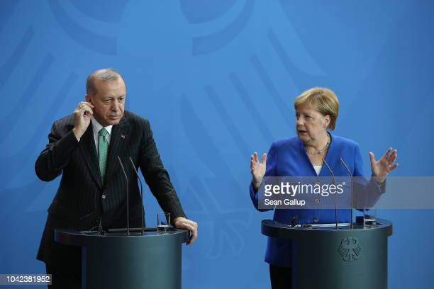 Turkish President Recep Tayyip Erdogan and German Chancellor Angela Merkel speak to the media at the Chancellery on September 28 2018 in Berlin...