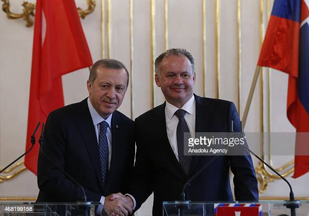 Turkish President Recep Tayyip Erdogan and his Slovakian counterpart Andrej Kiska shake hands after a joint press conference at the Presidential...