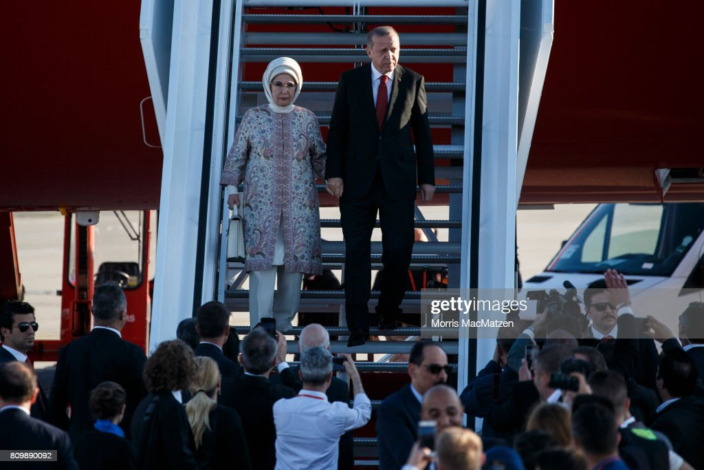 Turkish President Recep Tayyip Erdogan and his wife Emine arrive at Hamburg Airport for the Hamburg G20 economic summit on July 6, 2017 in Hamburg, Germany. Leaders of the G20 group of nations are meeting for the July 7-8 summit. Topics high on the agenda for the summit include climate policy and development programs for African economies.