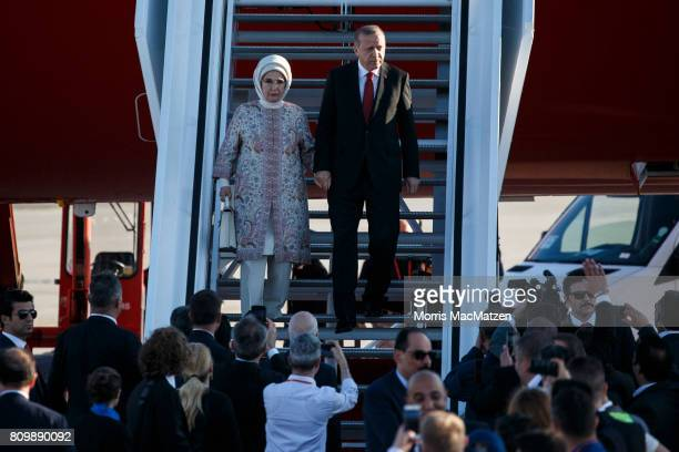 Turkish President Recep Tayyip Erdogan and his wife Emine arrive at Hamburg Airport for the Hamburg G20 economic summit on July 6 2017 in Hamburg...