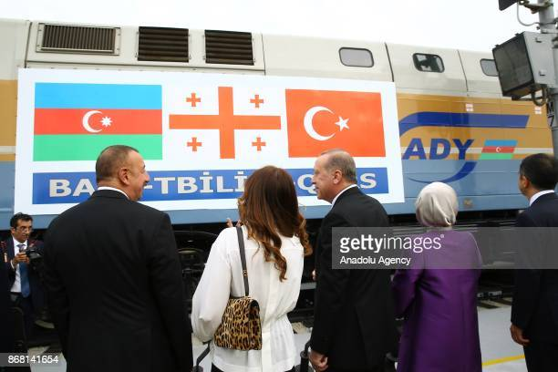 Turkish President Recep Tayyip Erdogan and his wife Emine Erdogan and Azerbaijani President Ilham Aliyev attend the opening ceremony of the first...
