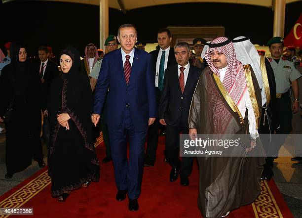 Turkish President Recep Tayyip Erdogan and his wife Emine Erdogan are welcomed by Governor Bin Macit at the King Abdulaziz International Airport in...