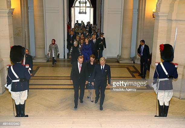 Turkish President Recep Tayyip Erdogan and his wife Emine Erdogan are welcomed by Belgian King Philippe and Queen Mathilde during an official...