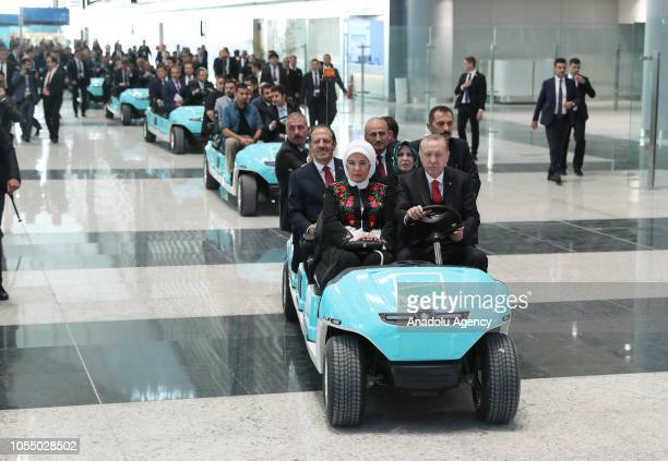 Turkish President Recep Tayyip Erdogan and his wife Emine Erdogan arrive at the ceremony area by a golfcart ahead of the opening ceremony of...