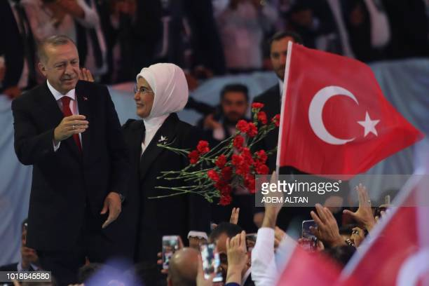 TOPSHOT Turkish President Recep Tayyip Erdogan and his wife Emine Erdogan greet supporters of the ruling Justice and Development Party during the...