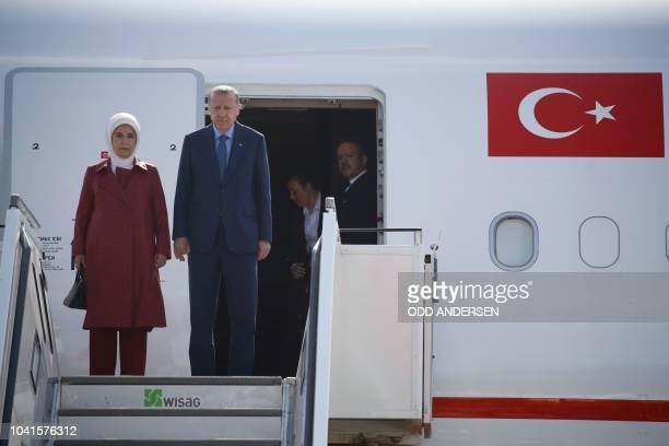Turkish President Recep Tayyip Erdogan and his wife Emine Erdogan disembark their plane after landing at Berlin's Tegel airport on September 27 2018...