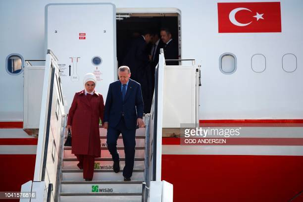 Turkish President Recep Tayyip Erdogan and his wife Emine Erdogan disembark their plane after landing at Berlin's Tegel airport on September 27 2018...