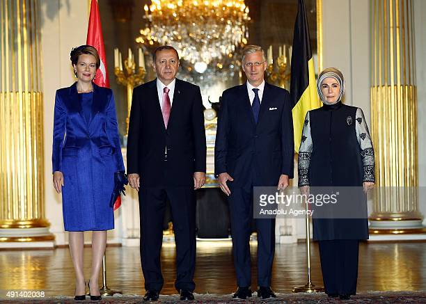 Turkish President Recep Tayyip Erdogan and his wife Emine Erdogan pose with Belgian King Philippe and Queen Mathilde during an official welcoming...