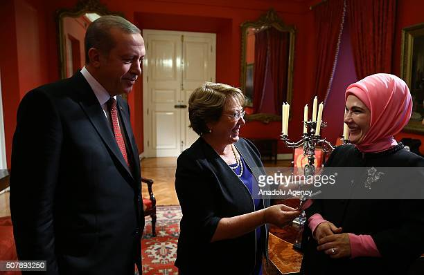 Turkish President Recep Tayyip Erdogan and his wife Emine Erdogan speak with President of Chile Michelle Bachelet before a dinner will be given in...