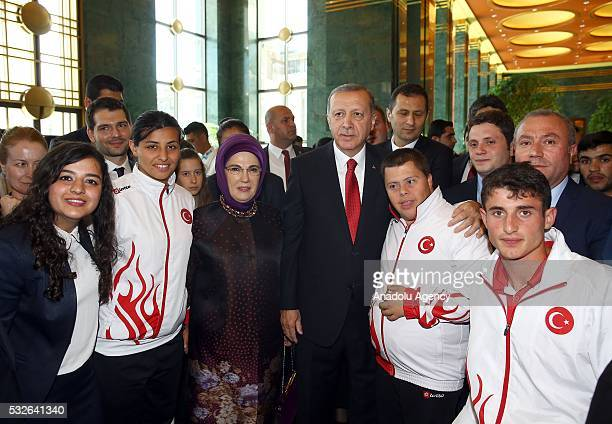 Turkish President Recep Tayyip Erdogan and his wife Emine Erdogan pose with the guests as he receives young people and athletes came from varied...