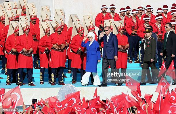 Turkish President Recep Tayyip Erdogan and his wife Emine Erdogan salute the participants attend the celebrations of the 563rd anniversary of...