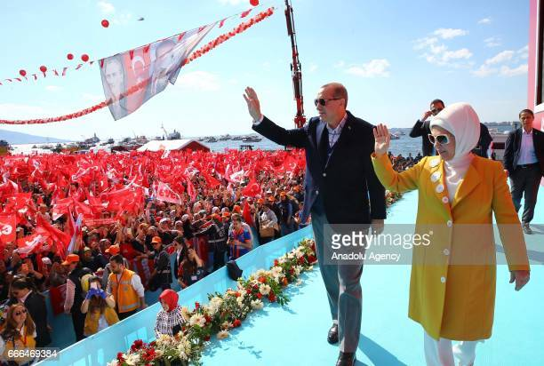 Turkish President Recep Tayyip Erdogan and his wife Emine Erdogan greet the crowd during 'Izmir Gathering' which is also attended by Turkey's Prime...