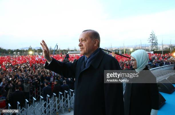 Turkish President Recep Tayyip Erdogan and his wife Emine Erdogan salute the crowd who are celebrating the results of the referendum at the...