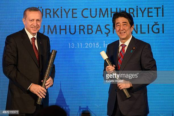 Turkish President Recep Tayyip Erdogan and Japanese Prime Minister Shinzo Abe pose with posters of the movie Ertugrul 1840 a film made by Japan and...