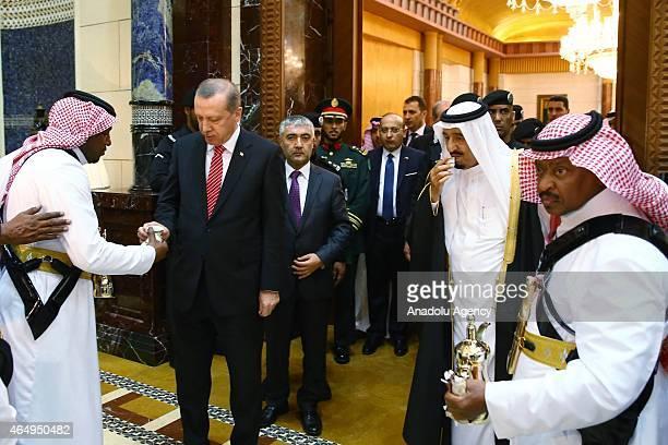 Turkish President Recep Tayyip Erdogan and King of Saudi Arabia, Salman bin Abdulaziz Al Saud drink Arabic Coffee ahead of their meeting at Riyadh's...