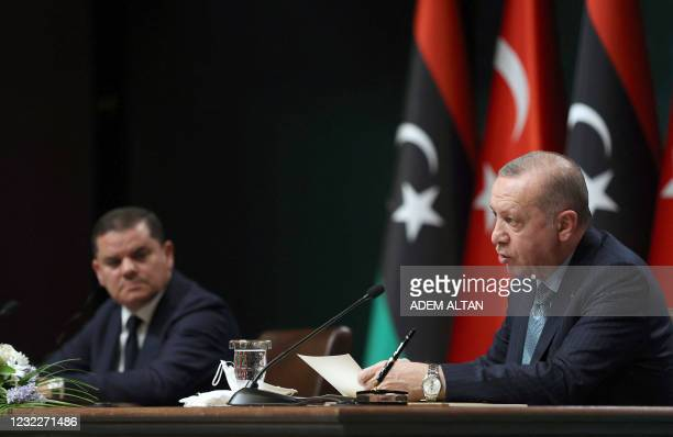 Turkish President Recep Tayyip Erdogan and Libyan Government of National Unity Prime Minister Abdul Hamid Dbeibah attend a signing ceremony after...