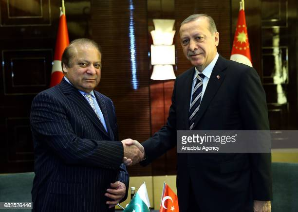Turkish President Recep Tayyip Erdogan and Prime Minister of Pakistan Nawaz Sharif shake hands as they pose for a photo before their meeting in...