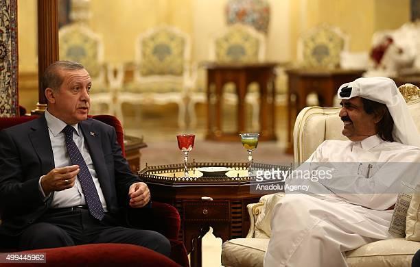 Turkish President Recep Tayyip Erdogan and Qatar's emir Sheikh Hamad bin Khalifa Al Thani meet in Doha the capital city of Qatar on December 01 2015
