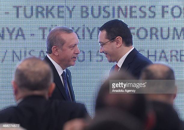 Turkish President Recep Tayyip Erdogan and Romanian Prime Minister Victor Ponta shake hands during TurkeyRomania business forum at Romania chamber of...