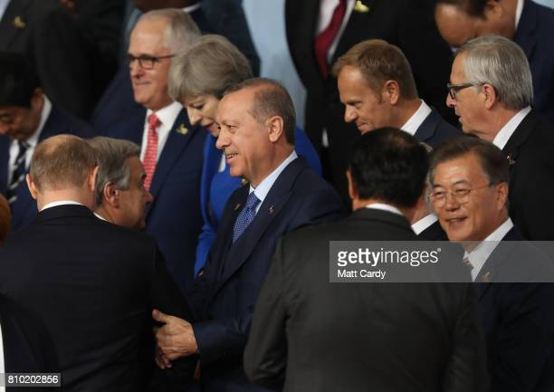 Turkish President Recep Tayyip Erdogan and Russian President Vladimir Putin arrives for a family photo during the G20 summit on July 7 2017 in...