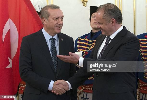 Turkish President Recep Tayyip Erdogan and Slovak President Andrej Kiska pose before their meeting at the presidential palace in Bratislava Slovakia...